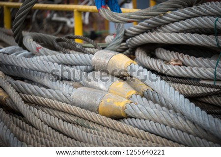 Rigging rope on a quay in the dock. #1255640221