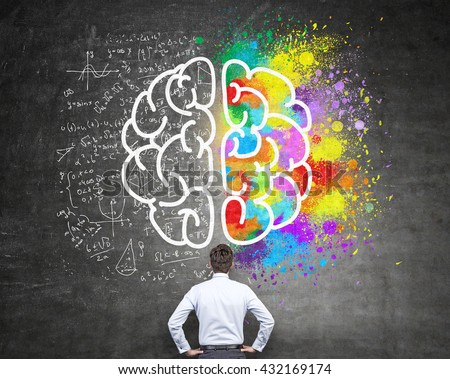 Right and left hemispheres, creative and analytical thinking concept with businessman looking at chalkboard with sketch