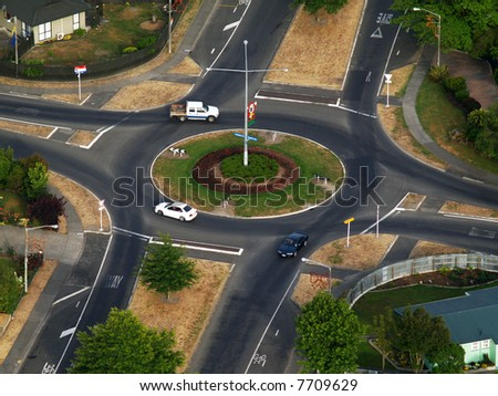 Right Hand Drive Roundabout with Three Vehicles Taken from a balloon
