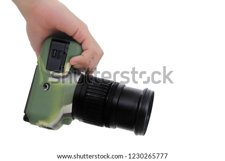 Right hand holding the camera DSLR wear silicone camouflage pattern.