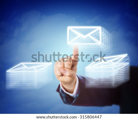 Right hand of a white collar worker is busy moving email between two stacks of mail documents. Business concept for overtime, work load, efficiency, overwhelming task, throughput and administration.