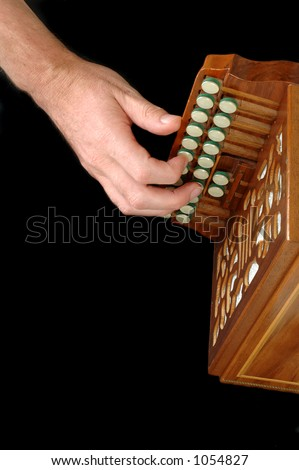 Right hand on accordion - stock photo