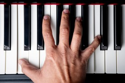 right hand playing a C Octave on the piano
