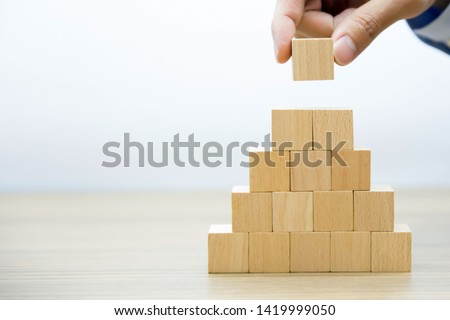 Right hand side  Fifteen Wooden cube Stacked in  Pyramid shape  without graphics for Business and design concept, Symbol of leadership, Teamwork and Growth. #1419999050