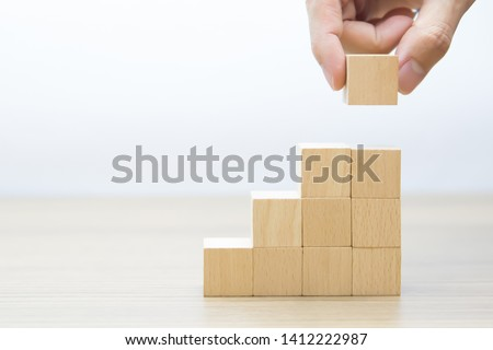 Right hand side Wooden cube Stacked in Triangle shape  without graphics for Business and design concept, Symbol of leadership, Teamwork and Growth. #1412222987