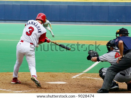 Right-handed baseball batter swinging at a pitch