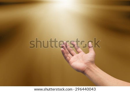 right hands praying  on blurred sepia tone background : hand open receiving power from god. religion concept.