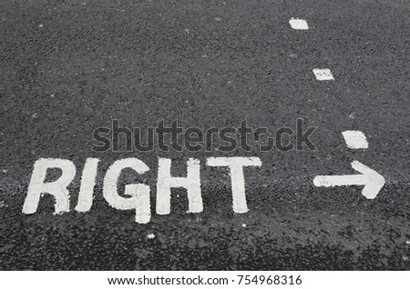 Right painted on a road surface #754968316