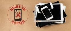 right to repair symbol next to broken tablets and smart phones on board consumer right to repair goods