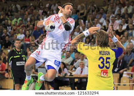 RIJEKA, CROATIA - JUL 12: Ivano Balic (#21) and Andreas Nilsson (#35) on  Friendly Handball Match Croatia (white) vs. Sweden (yellow) on July 12, 2012 in Croatia, Rijeka
