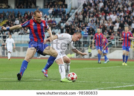 "RIJEKA, CROATIA - MARCH 21: soccer match ""Rijeka""(white) and ""Hajduk"" (red-blue). First Croatian Football League. Srdjan Andric left and Diego Zivulic right in duel.  March 21 2012 in Rijeka, Croatia"