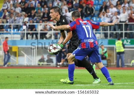 RIJEKA, CROATIA SEPTEMBER 28: soccer derby match NK Rijeka (white) vs. NK Hajduk (blue-red) on September 28, 2013 in Rijeka.