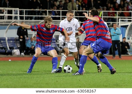 "RIJEKA, CROATIA - SEPTEMBER 28: soccer match between ""HNK Rijeka"" and ""HNK Hajduk"". Andro Svrljuga surrounded by  undefined players. (First Croatian Football League) SEPT 28 2010 in Rijeka, Croatia"