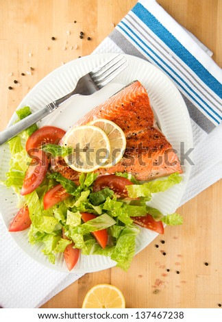 rilled Salmon Fillet Served with Tomatoes and Romaine Salad