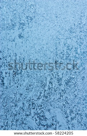 rime on a window glass (abstract winter background)