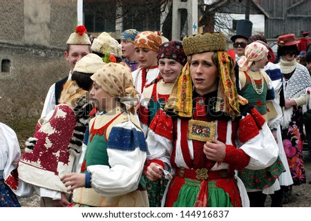 RIMETEA - FEB 28: Local unidentified villagers of Rimetea (Torocko) attending a unique show, the celebration and carnival with mask at the ending of winter. On February 28, 2009, in Rimetea, Romania.