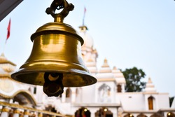 Ring bells in temple. Golden metal bell isolated. Big brass Buddhist bell of Japanese temple. Ringing bell in temple is belief auspicious. Bangkok, Thailand