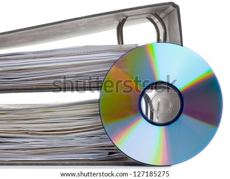 Ring binder with compact disc over white background - digital storage concept