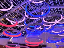 Ring color lamps. Abstract background of lamps. Modern lamps in the form of rings under a glass ceiling