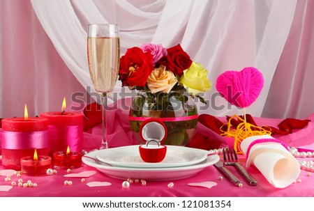 Ring in gift box on celebratory table  of Valentine's Day on white fabric background