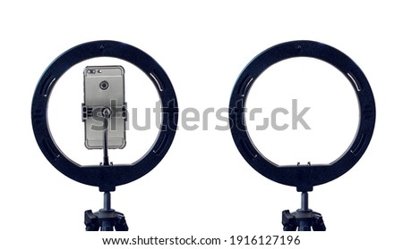 ring lamp and a smartphone on a tripod, isolated on a white background with a clipping path. inexpensive equipment for home video or photo shooting. Photo stock ©