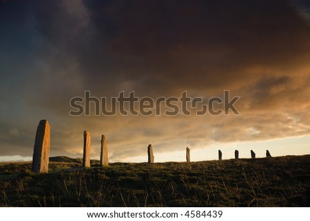 Ring of Brodgar in dramatic evening light and cloudscape