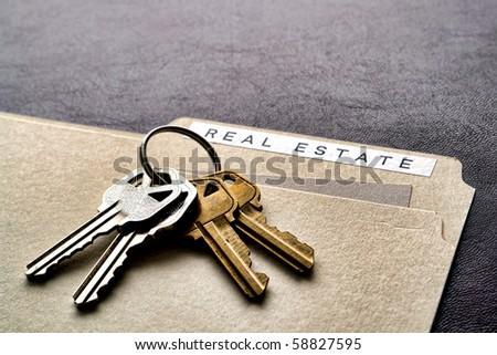 Ring set of house keys on a real estate file folder on a desk