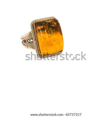 Ring with amber on a white background