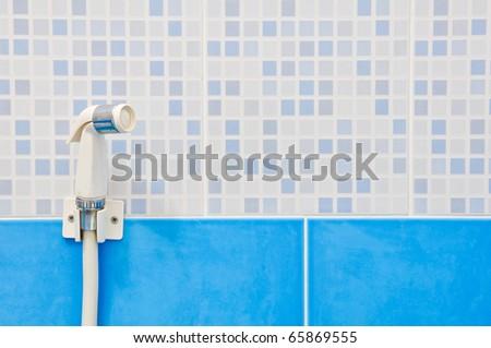 Rinsing Spray or Bidet on the blue sky ceramic background