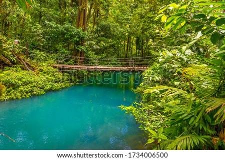 Rio Celeste with turquoise, blue water and small wooden bridge Tenorio national park Costa Rica. Central America. Foto d'archivio ©