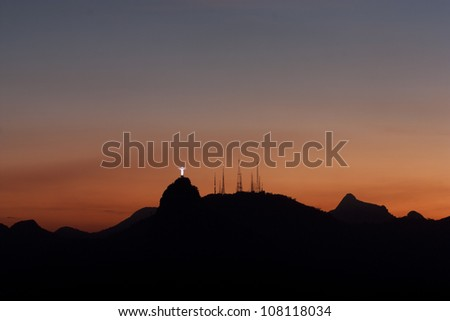 Rio de Janeiro at sunset, view from Sugarloaf mountain on Corcovado mountain and Christ the redeemer statue