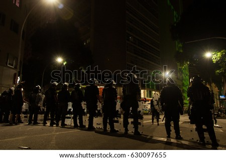 Rio de Janeiro, Brazil - 28 April, 2017: Military police in the street during the protest against drastic labor changes in the country. - Shutterstock ID 630097655