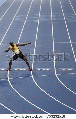 Rio de Janeiro, Brazil - august 18, 2016: Runner Usain Bolt (JAM) during 800m Men's run in the Rio 2016 Olympics #703232518