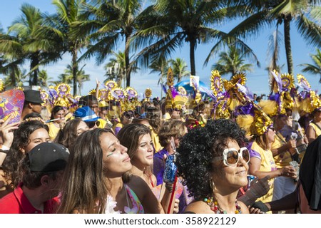 RIO DE JANEIRO, BRAZIL - FEBRUARY 07, 2015: Brazilians celebrate at a carnival street party on a sunny summer afternoon along Ipanema Beach. #358922129