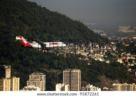 RIO DE JANEIRO, BRAZIL - FEBRUARY 4: TAM Airlines aircraft prepare for landing on February 4, 2012, Rio de Janeiro, Brazil. TAM is a new airline born after the national airline Varig went to bankrupt.