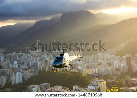 Rio de Janeiro, Brazil. Helipad with helicopter taking off from Urka mountain viewpoint on sunset. #1448710568