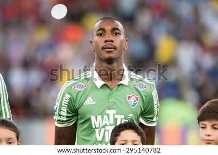 RIO DE JANEIRO, BRAZIL - June 09, 2015: Gerson player is presented during the National Anthem. Fluminense is facing Cruzeiro at Maracana Stadium.