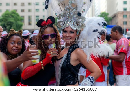 Rio de Janeiro, Brazil - March 3, 2014: People having a good time and posing in festive costumes at a carnival block party in the city centre of Rio de Janeiro #1264156009