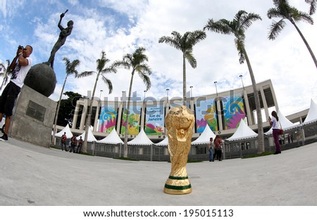 RIO DE JANEIRO BRAZIL May 26 2014 A replica of the FIFA World Cup Trophy in front of Maracana Stadium 16 days before the World Cup opening ceremony on June 12 2014 in Sao Paulo