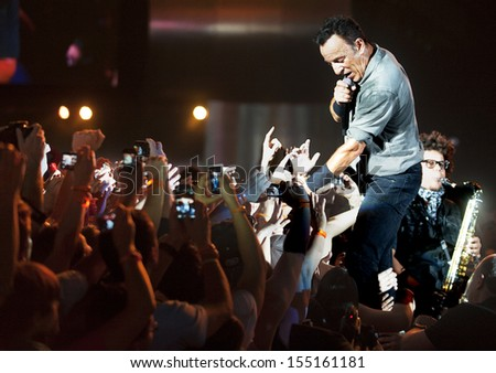 RIO DE JANEIRO BRAZIL SEPTEMBER 21 US singer Bruce Springsteen performs among the audience during the Rock in Rio 2013 concert on September 21 2013 in Rio de Janeiro Brazil