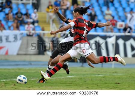 RIO DE JANEIRO - DECMBER 04: Player Ronaldinho Gaucho in action during the Brazilian Championship match between Vasco vs Flamengo at Engenhao Stadium on December 04, 2011 in Rio de Janeiro, Brazil.