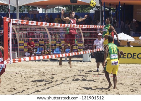 RIO DE JANEIRO - MARCH 10: Andrade, player of  the team of Portugal, makes an attack play.   Event Mundial de Futevolei 4 X 4 2013,  March 10, 2013 in Rio de Janeiro, Brazil