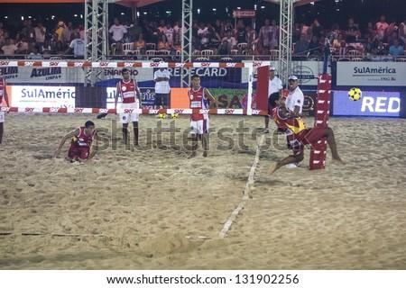 RIO DE JANEIRO - MARCH 09: Donato, player of  the team of the Spain makes a defensive play.  Event Mundial de Futevolei 4 X 4 2013,  March 09, 2013 in Rio de Janeiro, Brazil