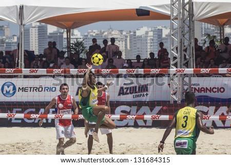RIO DE JANEIRO - MARCH 09: Game of the teams Brasil A and Paraguay. Event Mundial de Futevolei 4 X 4 2013,  March 09, 2013 in Rio de Janeiro, Brazil