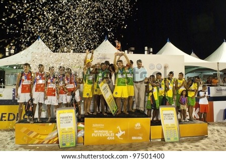 RIO DE JANEIRO - MARCH 10: podium with the three winners teams Paraguay team, Brazil 2 Team and Brazil 1 team at II World Cup of Futevalei Sulamerica 4x4 event March 10, 2012 in Rio de Janeiro,  Brazil
