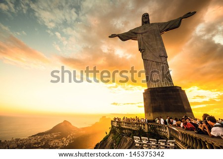 RIO DE JANEIRO, MARCH 3: Tourists are happy to see the first sunset after a week of rain and thunderstorms on the Corcovado Hill - march 3, 2013 in Rio de Janeiro, Brazil