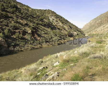 Rio Grande flowing across desert south of Taos, New Mexico