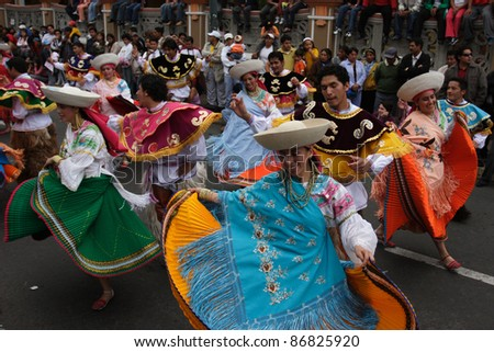 RIOBAMBA, ECUADOR - JANUARY 14:  Dancers perform on annual carnival on the main street of Riobamba January 14, 2008 in Riobamba, Ecuador.