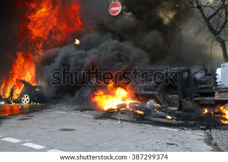 Riots in the city, citizens in conflict with the power harness tires and vehicles police disperse demonstrators in Europe, protesting people fighting for their rights, is also breaking the law