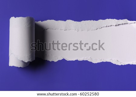 Rip Blue Paper and white background with space for text